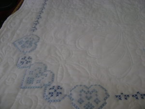 Blue cross stitch quilt inside corner