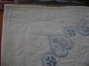 Blue cross stitch quilt corners