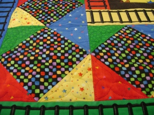 pieced blocks of circus train quilt