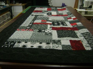 Black, white, and red quilt